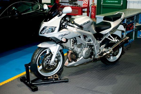 Moottoripyöräteline, Laser